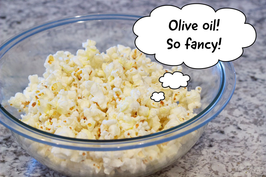 Popcorn in bowl saying olive oil, so fancy!
